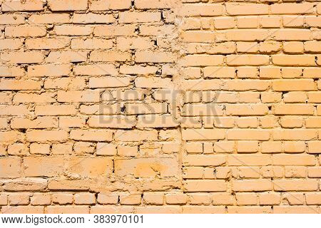Brickwork Background. Brick Wall Texture. Sloppy Brick Masonry Of Orange Color.