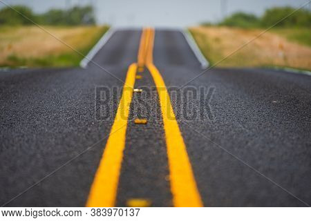 Asphalt Road In Usa. View Of Highway Road Running Through The Barren Scenery Of The American Southwe