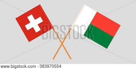 Crossed Flags Of Madagascar And Switzerland. Official Colors. Correct Proportion. Vector Illustratio