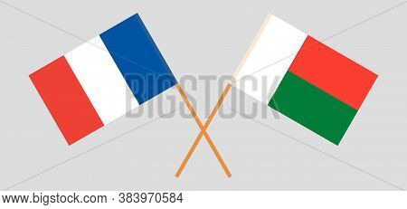 Crossed Flags Of Madagascar And France. Official Colors. Correct Proportion. Vector Illustration