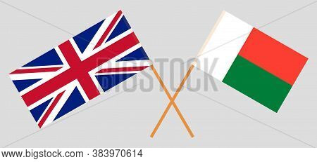 Crossed Flags Of Madagascar And The Uk. Official Colors. Correct Proportion. Vector Illustration