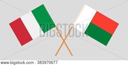 Crossed Flags Of Madagascar And Italy. Official Colors. Correct Proportion. Vector Illustration