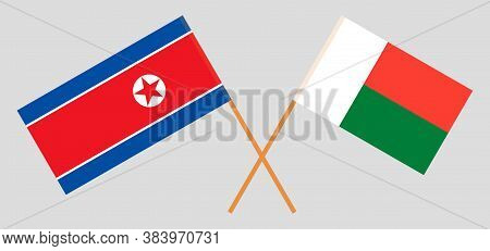 Crossed Flags Of Madagascar And North Korea. Official Colors. Correct Proportion. Vector Illustratio