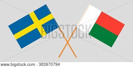 Crossed Flags Of Madagascar And Sweden. Official Colors. Correct Proportion. Vector Illustration