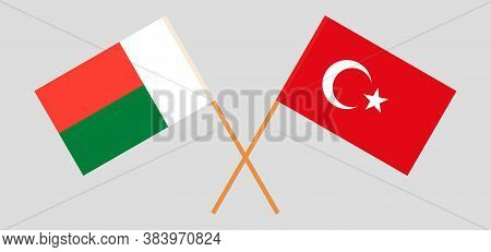 Crossed Flags Of Madagascar And Turkey. Official Colors. Correct Proportion. Vector Illustration