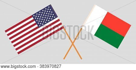 Crossed Flags Of Madagascar And The Usa. Official Colors. Correct Proportion. Vector Illustration