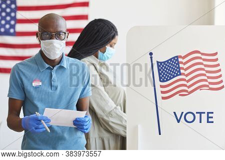Waist Up Portrait Of African-american Man Standing By Voting Booth Decorated With Usa Flag And Looki