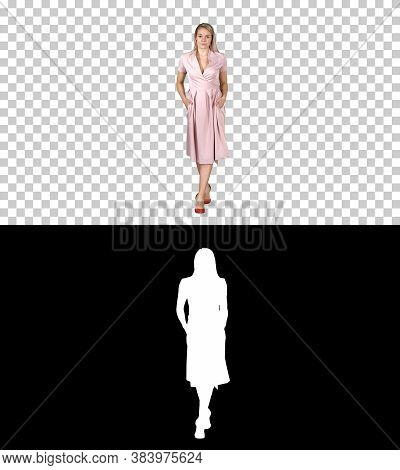 Woman In Pink Dress With Hands In Pockets Is Walking Towards The Camera, Alpha Channel