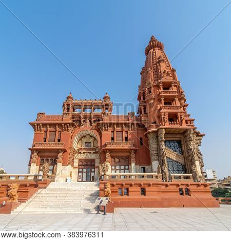 Low Angle View Of Front Facade Of Baron Empain Palace, A Historic Mansion Inspired By The Cambodian