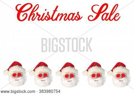 Christmas Holiday Sales. Santa Claus wearing Red Sunglasses isolated on white with