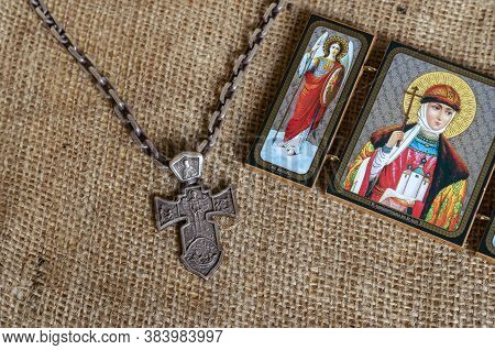 A Massive Silver Pectoral Cross With The Image Of The Archangel Michael And An Orthodox Icon. The Ic