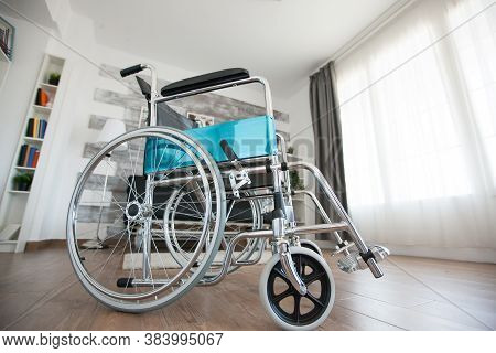 Wheelchair In Private Hospital Room For Patients With Walking Handicap. No Patient In The Room In Th