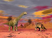 Two prehistorical animals in the desert by cloudy sunset poster