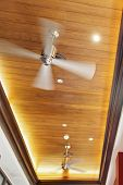 generic take of a row of ceiling mounted fans found in most contemporary homes in the tropics. Location of shot Goa India poster