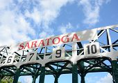 Horse race track gates in Saratoga, New York poster