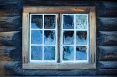 Window of a traditional Norwegian hut with frost patterns poster