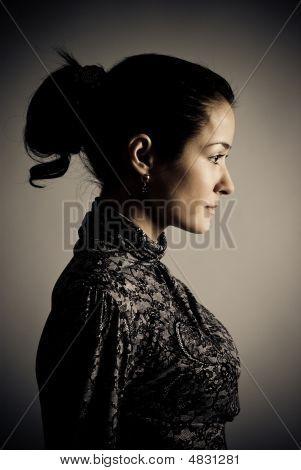 Low-key Half Face Portrait Of Beautiful Woman