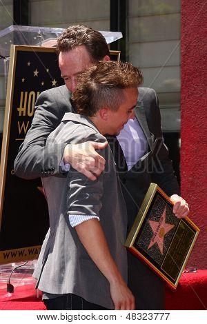 LOS ANGELES - JUL 16:  Frankie Muniz, Bryan Cranston at the Hollywood Walk of Fame Star Ceremony for Bryan Cranston at the Redbury Hotel on July 16, 2013 in Los Angeles, CA