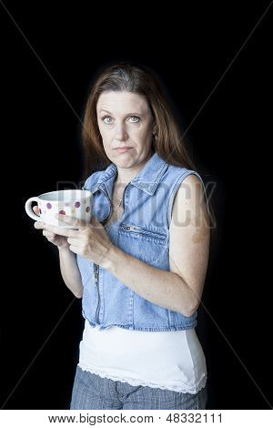 Middle Aged Woman With Strange Facial Expression And Coffee Cup