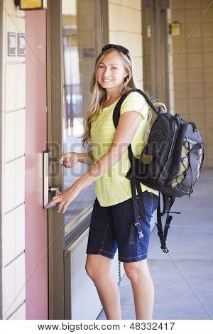 Woman unlocking her Hotel Room Door