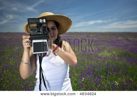 Young Woman With Instant Photo Camera