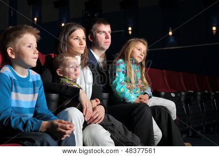 Family watching a movie in the cinema.  poster