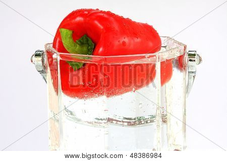 fresh red sweet pepper in water