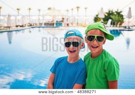 Smiling Boys At The Swimming Pool