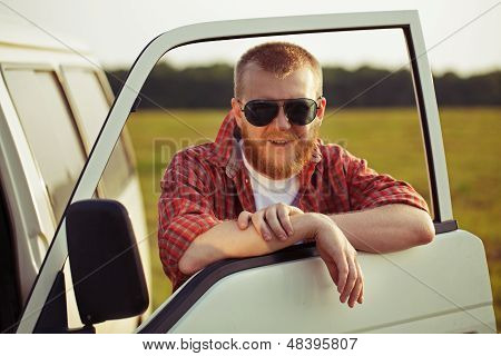 Driver Of A Truck In Sunglasses