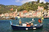Oil painting effect on boat anchored in the village of Portofino in the Italian Riviera poster