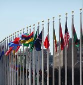 Some of the flags in front of the United Nations in NYC poster