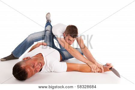 Two Men Fighting For A Knife