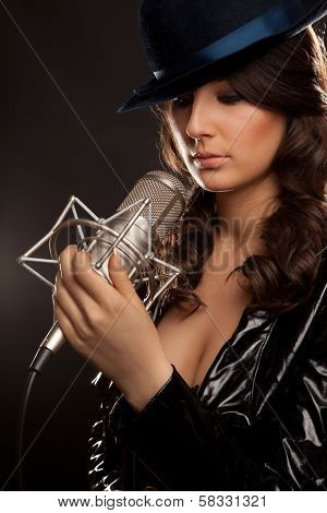 Picture Of Singer With Studio Microphone