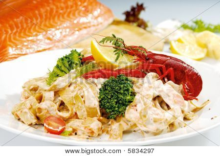 Craw fish on the top of pasta and vegetable poster