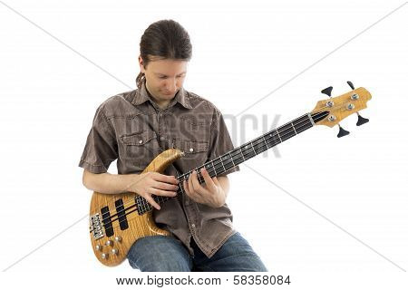 Bass guitarist playing a bass guitar (Series with the same model available) poster