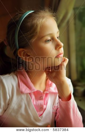 The girl dreaming at a window
