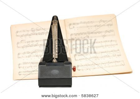 Metronome On Sheet Music Background