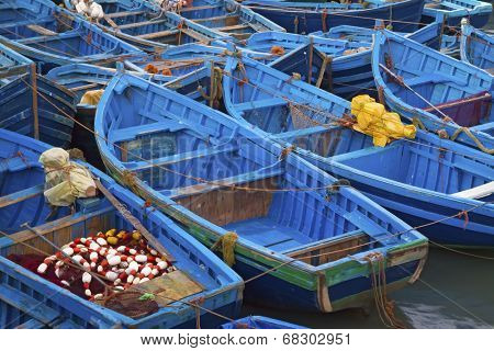 Blue fishing boats in Essaouira port, Atlantic coast, Morocco, Africa poster