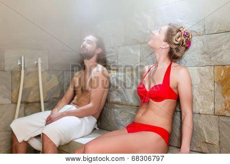 Couple in wellness spa steam bath