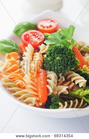 Italian pasta primavera with broccoli and baby carrot
