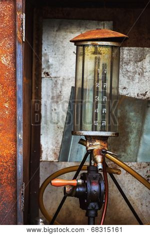 The Drum Of Fuel And Hand Pump In Old Gasoline Station