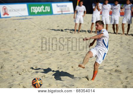 MOSCOW, RUSSIA - JULY 13, 2014: Bogomolov, Kazakhstan performs penalty shoot-out in the match with Estonia during Moscow stage of Euro Beach Soccer League. Kazakhstan won 3:2 after penalty shoot-out