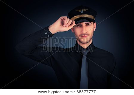 Young pilot wearing black shirt and tie salute portrait on black background poster