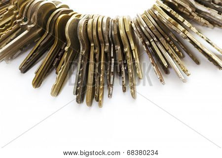Many old brass keys on white background. Security and encryption, concept image.