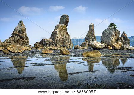 poster of Kushimoto, Wakayama Prefecture, Japan. coastline at Hashi-gui-iwa rocks.