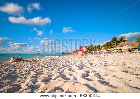 tourists enjoying sunset in Isla Mujeres, Mexico