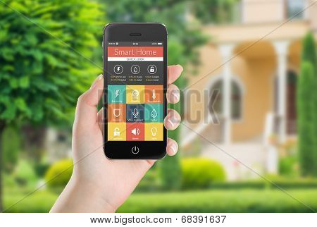 Black Mobile Smart Phone With Smart Home Application Icons On The Screen In Female Hand