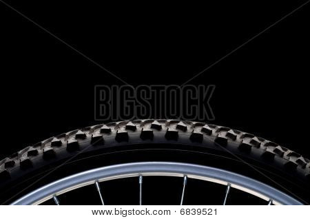 Mountain Bike Tire And Rim On Black With Copy Space