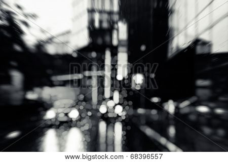Bad weather driving in downtown - business district poster