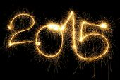 New Year 2015 formed from sparking digits over black background poster